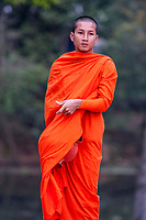 Cambodia, Bakong.  Young Buddhist Monk, Early Morning.