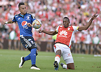 BOGOTÁ -COLOMBIA, 17-05-2015. Yerry Mina (Der) jugador de Independiente Santa Fe disputa el balón con Fernando Uribe (Izq) jugador de Millonarios durante partido por la fecha 20 de la Liga Aguila I 2015 jugado en el estadio Nemesio Camacho El Campín de la ciudad de Bogotá./ Yerry Mina (R) player of Independiente Santa Fe fights for the ball with Fernando Uribe (L) player of Millonarios during the match for the 20th date of the Aguila League I 2015 played at Nemesio Camacho El Campin stadium in Bogotá city. Photo: VizzorImage/ Gabriel Aponte / Staff