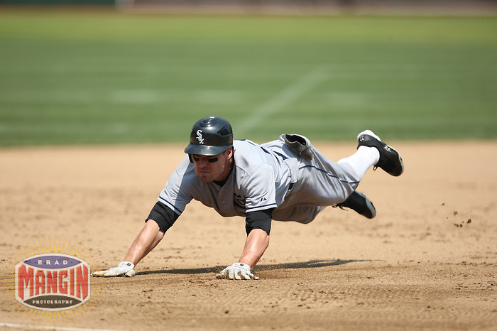 OAKLAND, CA - AUGUST 16:  Scott Podsednik #22 of the Chicago White Sox slides safely into third base with a triple against the Oakland Athletics during the 1929-themed turn back the clock game at the Oakland-Alameda County Coliseum on August 16, 2009 in Oakland, California. Photo by Brad Mangin
