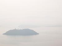 Misty view of an island in Lake Kivu, Rwanda