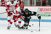 BOSTON, MA - JANUARY 11: Natasza Tarnowski #13 of Boston University and Ciara Barone #16 of Providence College battle for the puck during a game between Providence College and Boston University at Walter Brown Arena on January 11, 2020 in Boston, Massachusetts.