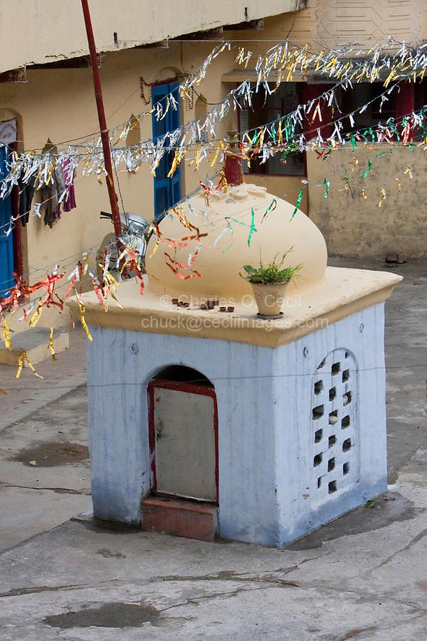 India, Rishikesh.  Residential Courtyard with Shrine.