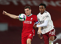 1st October 2020; Anfield, Liverpool, Merseyside, England; English Football League Cup, Carabao Cup, Liverpool versus Arsenal; James Milner of Liverpool competes for the ball with Joe Willock of Arsenal