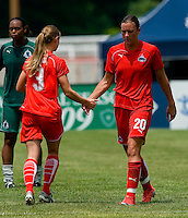Washington Freedom defender/midfielder Jill Gilbeau (3) replaces Washington Freedom forward Abby Wambach (20)  during a WPS match at Anheuser-Busch Soccer Park, in Fenton, MO, June 20 2009. Washington  won the match 1-0.