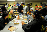 Philip Lebherz (center, white cap), a part owner in Kentucky Derby hopeful Sway Away, talks with Ahmed Zayat (seated at right) and his family about Nehro, the Derby and racing luck during breakfast at Wagner's Pharmacy across the street from Churchill Downs in Louisville, Kentucky on May 3, 2011.