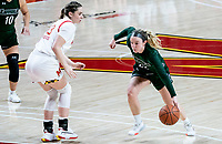 COLLEGE PARK, MD - DECEMBER 8: Bri Rozzi #22 of Loyola dribbles past Faith Masonius #13 of Maryland during a game between Loyola University and University of Maryland at Xfinity Center on December 8, 2019 in College Park, Maryland.