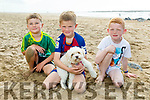 Éanna and Jack Blake and Jake Bennett from Ballybunion with Biscuits the dog enjoying the sunny after afternoon on Ballybunion Beach on Tuesday