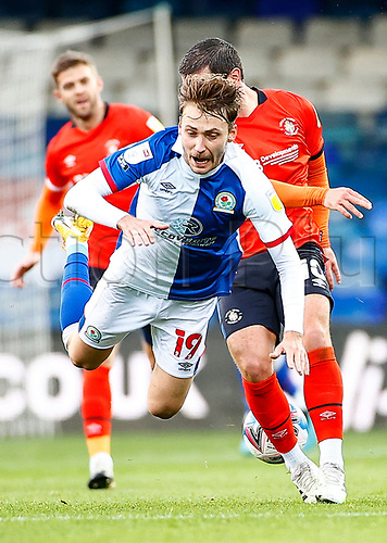 21st November 2020; Kenilworth Road, Luton, Bedfordshire, England; English Football League Championship Football, Luton Town versus Blackburn Rovers; Tom Trybull of Blackburn Rovers tripped up by Elliot Lee of Luton Town
