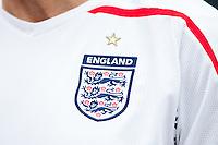 The England shirt and badge