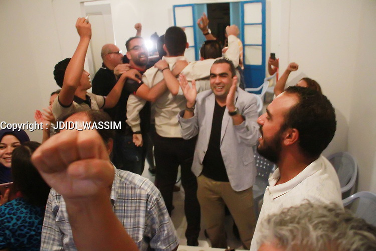 16 September 2019, Tunisia, Tunis: Independent presidential candidate Kais Saied, Tunisian jurist and professor of constitutional law, kisses the Tunisian national flag. Saied and media magnate Nabil Karoui, who was arrested last month on charges of money laundering and tax evasion, are set to face a run-off after a hotly-contested Tunisian presidential election that saw 26 contenders vying for the job, according to preliminary results from the electoral commission on Monday<br /> 16 September 2019, Tunisia, Tunis: Independent presidential candidate Kais Saied, Tunisian jurist and professor of constitutional law, kisses the Tunisian national flag. Saied and media magnate Nabil Karoui, who was arrested last month on charges of money laundering and tax evasion, are set to face a run-off after a hotly-contested Tunisian presidential election that saw 26 contenders vying for the job, according to preliminary results from the electoral commission on Monday<br /> <br /> PHOTO : Agence Quebec Presse -  JDIDI_WASSIM