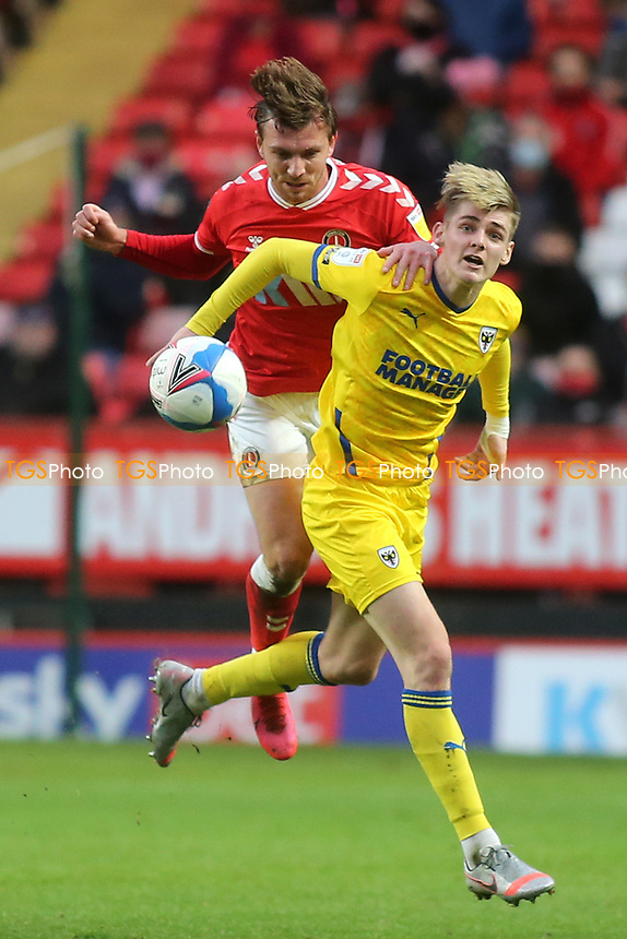 Alex Gilbey of Charlton Athletic and AFC Wimbledon's Jack Rudoni challenge for the ball during Charlton Athletic vs AFC Wimbledon, Sky Bet EFL League 1 Football at The Valley on 12th December 2020