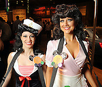 Pin-up girls Laura Makkaoui and Angela Holmes at the Cattle Baron's Ball at the George Ranch Saturday April 24,2010.. (Dave Rossman Photo)