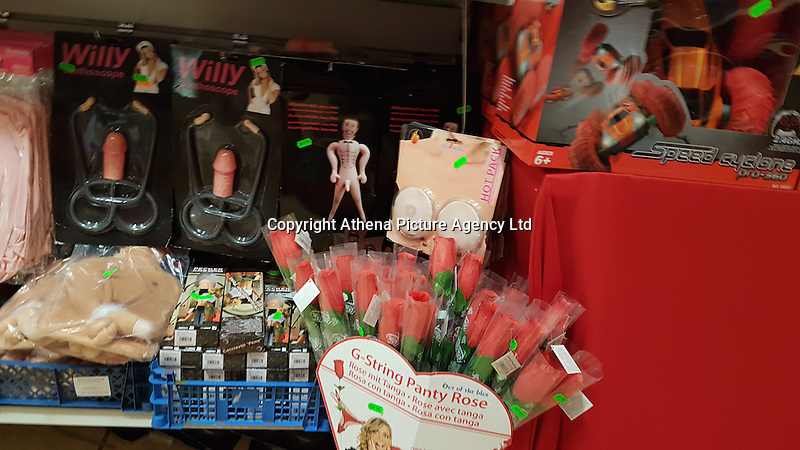 """Pictured: The penis-shaped novelties and gifts for sale at Christmas Wonderland pop-up shop in Swansea, Wales, UK<br /> Re: A pop-up trader has been condemned for """"peddling festive porn"""" by stocking raunchy boob and willy merchandise alongside the tinsel and mistletoe.<br /> Shocked families with young kids expecting to snap up a cheap bauble are greeted by inflatable penises, sponge willies and an array of gaudy erections doubling as money boxes.<br /> Bargain hunters in Swansea were drawn to the Christmas Wonderland pop-up shop when it appeared this week at the centre of the city's popular festive market.<br /> While some find the sexually explicit stock just a bit of fun, families are furious that very young kids are greeted with """"filth.""""<br /> Boasting """"Bargains Galore"""" a shop sign outside lists bows, tinsel, tags and Xmas wrap among its festive stock - but makes no mention of squeeze boobs or penis stethoscopes.<br /> """"My kids were all excited to go round the colourful Christmas market. But once we walked inside the kids came face to face with filth,"""" said a young mum, from Sketty, Swansea, who did not want to be named.<br /> """"My daughter is only seven and her brother's five. I would never knowingly let them go into a shop which stocks this kind of stuff.<br /> """"I don't want to sound like a prude but a shop like this should be for adults only. They are peddling festive porn. It's junk as far as l'm concerned."""
