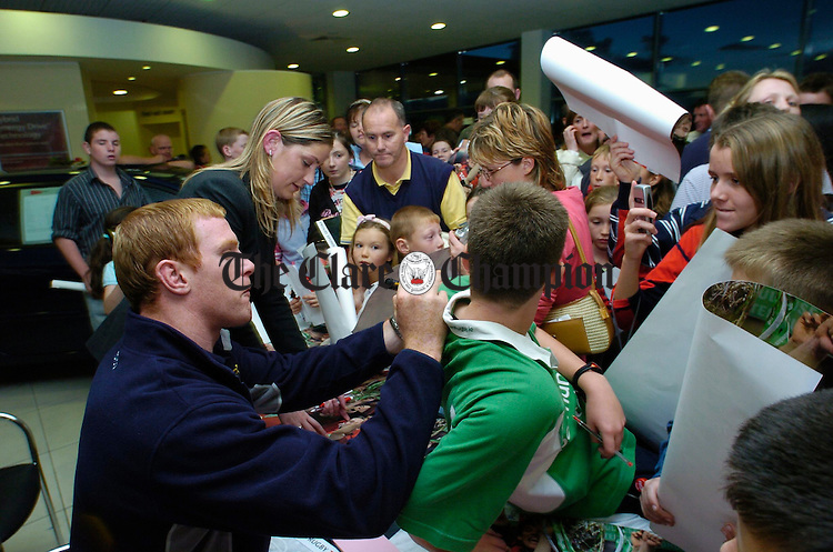 Paul O Connell of Munster rugby signs autographs for fans after his arrival at Tom Hogan Motors'  on the Gort Road in Ennis as part of the team members' visit to the Toyota showrooms with the Heineken cup. Photograph by John Kelly.