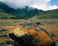 Lichen-covered boulders and clearing storm in Coyote Hills; Valley Falls, OR