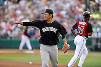 Starting pitcher Masahiro Tanaka (19) of the New York Yankees acknowledges a good play by a teammate in a Spring Training game against the Atlanta Braves on Wednesday, March 18, 2015, at Champion Stadium at the ESPN Wide World of Sports Complex in Lake Buena Vista, Florida. The Yankees won, 12-5. (Tom Priddy/Four Seam Images)