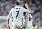 Cristiano Ronaldo of Real Madrid celebrates with teammate Nacho Fernandez during their 2016-17 UEFA Champions League Quarter-finals second leg match between Real Madrid and FC Bayern Munich at the Estadio Santiago Bernabeu on 18 April 2017 in Madrid, Spain. Photo by Diego Gonzalez Souto / Power Sport Images