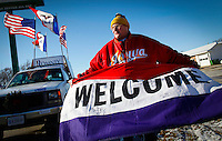 Edward Lewis of Wales, Iowa holds a welcome banner while waiting for the arrival of Mitt Romney outside The Family Table restaurant in Atlantic, Iowa on Sunday, January 1, 2012.  (Christopher Gannon/GannonVisuals.com/MCT)