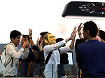 September 22, 2017, Tokyo, Japan - The first customer wearing a mask of Steve Jobs is greeted by Apple store employees as customers queue up to purchase Apple's iPhone 8 at an Apple store in Tokyo on Friday, September 22, 2017. The new iPhone 8 and 8 Plus featuring wireless battery charging are launched in Japanese market.    (Photo by Yoshio Tsunoda/AFLO) LWX -ytd-