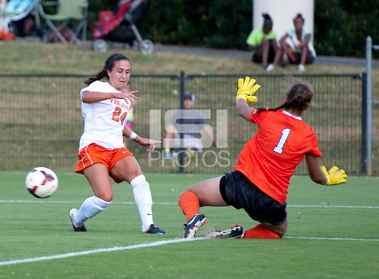 Danielle Colaprico (24) of Virginia passes the ball around Kailen Sheridan (1) of Clemson at Klockner Stadium in Charlottesville, VA.  Virginia defeated Clemson, 3-0.