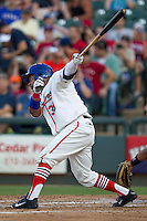 Wearing an Austin Senators throwback uniform, Round Rock Express designated hitter Manny Ramirez (39) follows through on his swing during the Pacific Coast League baseball game against the Oklahoma City RedHawks on July 9, 2013 at the Dell Diamond in Round Rock, Texas. Round Rock defeated Oklahoma City 11-8. (Andrew Woolley/Four Seam Images)