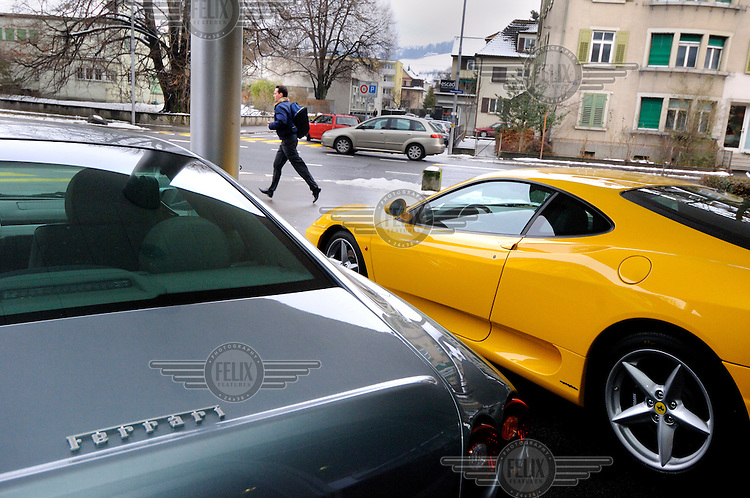 A Ferrari dealership sited on an anonymous corner in the town of Zug. The canton of Zug is a low tax region that is home to the HQs of many international companies.
