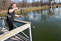 Joe Needham of Fayetteville lands a trout Dec. 26 2020 he caught with Power Bait at Lake Springdale.<br />(NWA Democrat-Gazette/Flip Putthoff)
