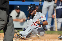 Detroit Tigers Alex Avila #13 slides into home during a Spring Training game vs the Toronto Blue Jays at Florida Auto Exchange Stadium in Dunedin, Florida;  February 26, 2011.  Detroit defeated Toronto 4-0.  Photo By Mike Janes/Four Seam Images