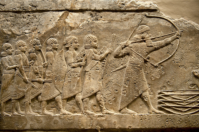 Assyrian relief sculpture panel of Ashurnasirpal lion hunting.  From Nineveh  North Palace, Iraq,  668-627 B.C.  British Museum Assyrian  Archaeological exhibit