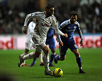 Pictured L-R: Angel Rangel of Swansea against Juan Mata of Chelsea. Tuesday, 31 January 2012<br /> Re: Premier League football Swansea City FC v Chelsea FCl at the Liberty Stadium, south Wales.