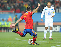David Villa, who scored two goals on the day, unleashes a shot from the edge of the area. Spain defeated Honduras, 2-0, in their second match of play in Group H  in a match played Monday, June 21st, at Ellis Park in Johannesburg, South Africa at the 2010 FIFA World Cup..