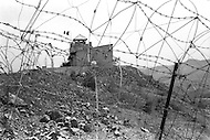 Mascara Area, Algeria, Summer 1961. Typical Miltary French Fort. Military and Civilians are looking at each other thru barbed wires and mine fields.