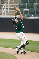 Catcher Tyler Belcher (27) of the Greensboro Grasshoppers catches a pop up behind home plate at Fieldcrest Cannon Stadium in Kannapolis, NC, Saturday August 24, 2008. (Photo by Brian Westerholt / Four Seam Images)