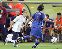 Bobby Convey of the USA tries to go around Cristian Zaccardo of Italy. The USA and Italy played to a 1-1 tie in their FIFA World Cup Group E match at Fritz-Walter-Stadion, Kaiserslautern, Germany, June 17, 2006.