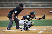 Wake Forest Demon Deacons catcher Ben Breazeale (9) sets a target as home plate umpire Michael Cerra looks on during the game against the Clemson Tigers at David F. Couch Ballpark on March 12, 2016 in Winston-Salem, North Carolina.  The Tigers defeated the Demon Deacons 6-5.  (Brian Westerholt/Four Seam Images)