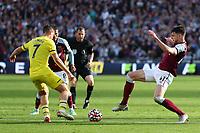 3rd October 2021;   City of London Stadium, London, England; EPL Premier League football, West Ham versus Brentford; Declan Rice of West Ham United challenges Sergi Canos of Brentford