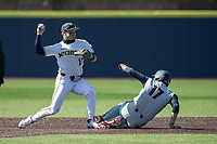 Michigan Wolverines second baseman Riley Bertram (12) turns a double play during the NCAA baseball game against the Illinois Fighting Illini on March 20, 2021 at Fisher Stadium in Ann Arbor, Michigan. Michigan won the game 8-1. (Andrew Woolley/Four Seam Images)