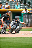 Austin Hedges (9) of the El Paso Chihuahuas on defense against the Salt Lake Bees in Pacific Coast League action at Smith's Ballpark on July 10, 2016 in Salt Lake City, Utah. Home plate umpire Clay Park handles the calls. El Paso defeated Salt Lake 11-2. (Stephen Smith/Four Seam Images)