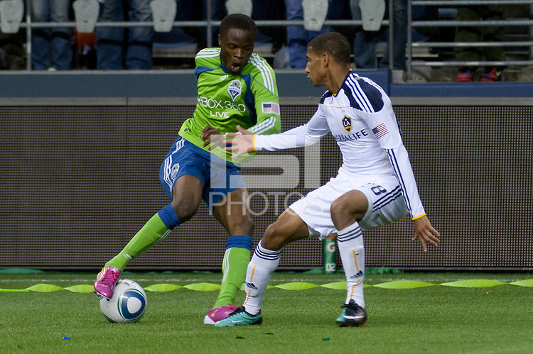 Steve Zakuani (l) of the Seattle Sounders works the ball against Los Angeles Galaxy defender Sean Franklin (r) in the first game of the 2010 MLS Playoffs at the XBox 360 Pitch at Quest Field in Seattle, WA on October 31, 2010. The Galaxy defeated the Sounders 1-0.