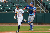 Tennessee Smokies catcher Kyle Schwarber (12) throws to first to complete the strike out of Joey Rickard (10) during a game against the Montgomery Biscuits on May 25, 2015 at Riverwalk Stadium in Montgomery, Alabama.  Tennessee defeated Montgomery 6-3 as the game was called after eight innings due to rain.  (Mike Janes/Four Seam Images)
