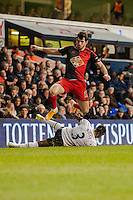 LONDON, ENGLAND - MARCH 04:  Nelson Oliveira of Swansea City jumps to avoid Danny Rose of Tottenham Hotspur during the Premier League match between Tottenham Hotspur and Swansea City at White Hart Lane on March 4, 2015 in London, England.  (Photo by Athena Pictures/Getty Images)