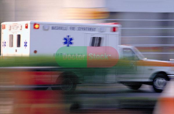 blurred ambulance speeding to emergency