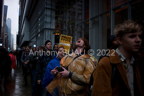 """New York, New York<br /> May 1, 2012<br /> <br /> May Day in Manhattan as demonstrators come out in strength to mark the day and support the """"Occupy"""" movement.<br /> <br /> Protesters march past the Bank of America building on 6th Ave and 42nd street."""