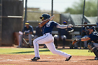 San Diego Padres infielder Eguy Rosario (1) follows through on his swing during an Instructional League game against the Milwaukee Brewers on September 27, 2017 at Peoria Sports Complex in Peoria, Arizona. (Zachary Lucy/Four Seam Images)