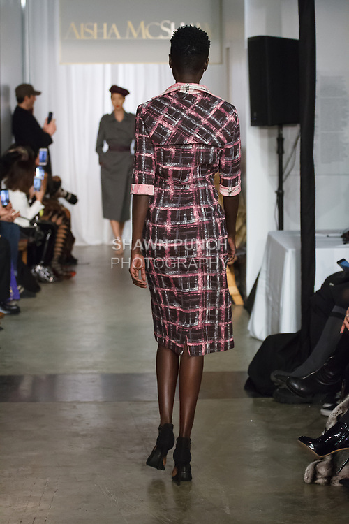 Model walks runway in an outfit from the Aisha McShaw Fall Winter 2019 collection on February 13, 2019 at The Prince George Ballroom during New York Fashion Week: Women's Fall Winter 2019.