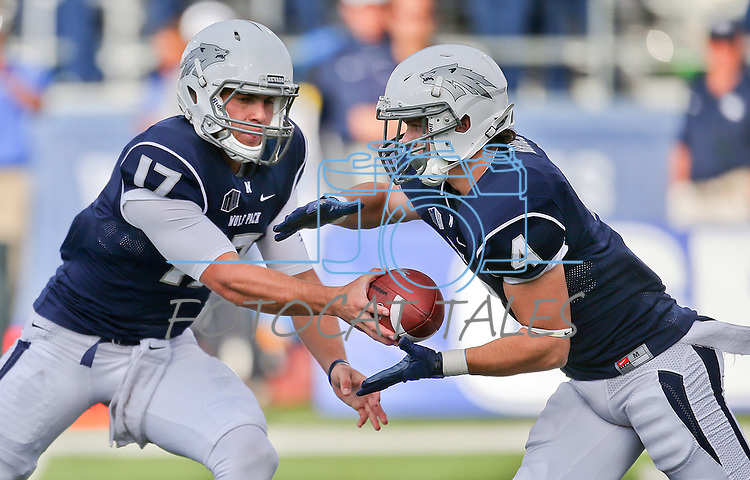 Nevada quarterback Cody Fajardo hands off to Kendall Brock during the first half of an NCAA football game against Air Force in Reno, Nev., on Saturday, Sept. 28, 2013.<br /> Photo by Cathleen Allison