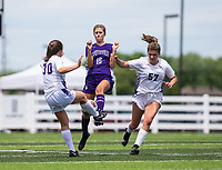 Abigail Estes (18) of Fayetteville tries to get the ball from Hannah Denery (30) of Mount Saint Mary's Academy at Wildcat Stadium, Springdale, Arkansas, Friday, May 14, 2021 / Special to NWA Democrat-Gazette/ David Beach