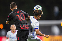 LAKE BUENA VISTA, FL - JULY 22: Kaku #10 of the New York Red Bulls and Frankie Amaya #24 of FC Cincinnati battle for the ball during a game between New York Red Bulls and FC Cincinnati at Wide World of Sports on July 22, 2020 in Lake Buena Vista, Florida.