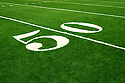 Angled color shot of a fifty-yard line and closeup of the numbers 50.