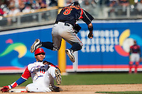 15 March 2009: #8 Akinori Iwamura of Japan jumps over  #10 Yulieski Gourriel of Cuba as he slides to second base during the 2009 World Baseball Classic Pool 1 game 1 at Petco Park in San Diego, California, USA. Japan wins 6-0 over Cuba.
